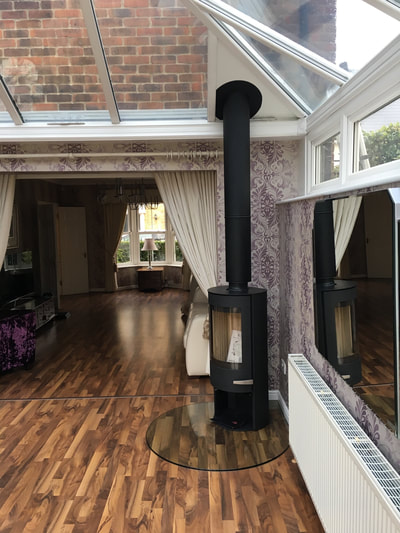 bespoke fireplace in conservatory